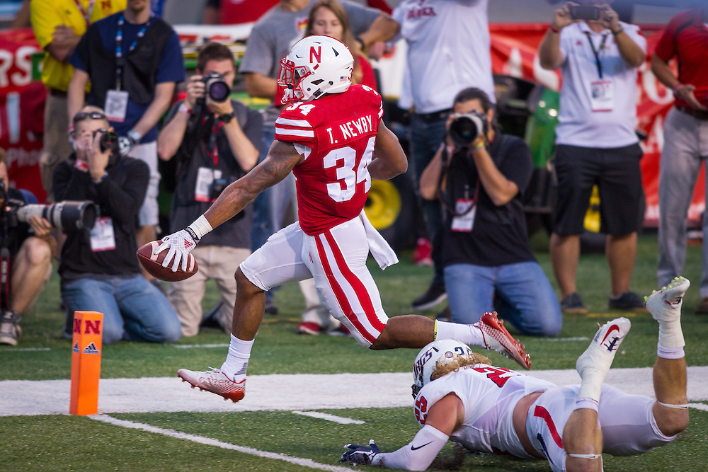 September 12, 2015: Terrell Newby #34 of the Nebraska Cornhuskers scores a touchdown against the South Alabama Jaguars at Memorial Stadium in Lincoln, Nebraska.  Nebraska 48 South Alabama 9.