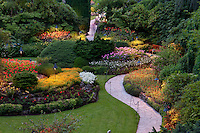 The lights change the look of Butchart Gardens, Victoria, BC, in the evening