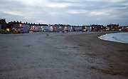 Sandy beach and seafront hotels at night, Weymouth, Dorset, England