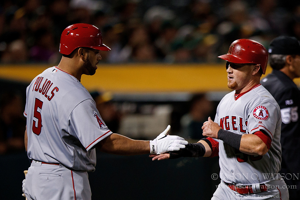 OAKLAND, CA - APRIL 04:  Kole Calhoun #56 of the Los Angeles Angels of Anaheim is congratulated by Albert Pujols #5 after scoring a run against the Oakland Athletics during the fifth inning at the Oakland Coliseum on April 4, 2017 in Oakland, California. The Los Angeles Angels of Anaheim defeated the Oakland Athletics 7-6. (Photo by Jason O. Watson/Getty Images) *** Local Caption *** Kole Calhoun; Albert Pujols