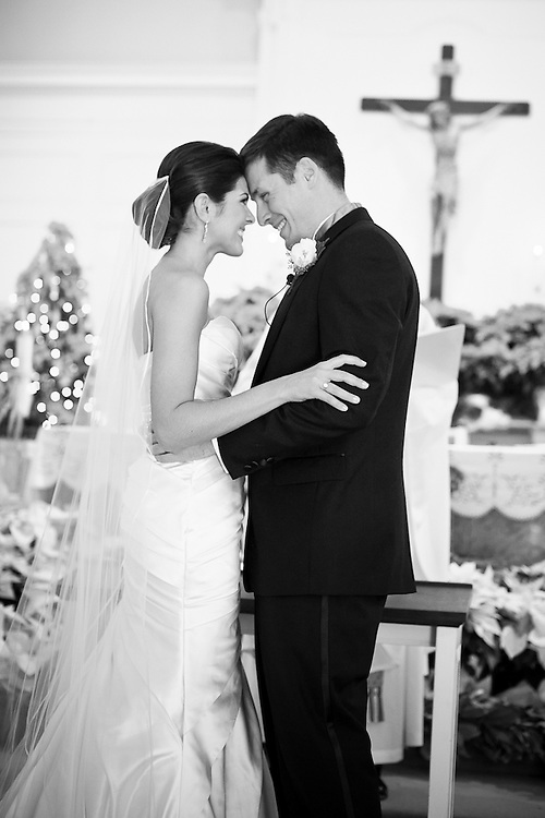 A Bride and Groom look at eachother ecstatically during their ceremony.