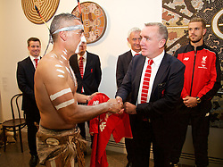 ADELAIDE, AUSTRALIA - Sunday, July 19, 2015: Liverpool's Managing Director Ian Ayre presents a shirt to Aboriginal dancer Karl Winda Telfe during a visit to the Art Gallery of South Australia ahead of a preseason friendly match against Adelaide United on day seven of the club's preseason tour. (Pic by David Rawcliffe/Propaganda)
