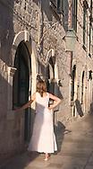 A girl in a white summer dress on an old<br /> back street in Dubrovnik, Croatia<br /> c. Ellen Rooney