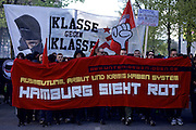 Hamburg | 01 May 2015<br /> <br /> About 1500 left-wing activists from several communist groups took part in a revolutionary May Day demonstration march against &quot;exploitation, poverty and war&quot; (Gegen Ausbeutung, Armut und Krieg) under the motto &quot;Hamburg sieht rot&quot;. The demonstration march started at Altona train station, from the very beginning of the rally there where violent clashes with police forces.<br /> <br /> &copy;peter-juelich.com<br /> <br /> [No Model Release | No Property Release]