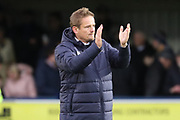 AFC Wimbledon manager Neal Ardley clapping during the EFL Sky Bet League 1 match between AFC Wimbledon and Luton Town at the Cherry Red Records Stadium, Kingston, England on 27 October 2018.