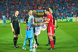 TRABZON, TURKEY - Thursday, August 26, 2010: Liverpool's captain Jamie Carragher and Trabzonspor's Ibrahima Yattara during the UEFA Europa League Play-Off 2nd Leg match at the Huseyin Avni Aker Stadium. (Pic by: David Rawcliffe/Propaganda)