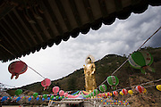 Songnisan National Park. Beopjusa Temple. The 33m high, 160 ton golden Buddha statue overlooks the wide-spread temple premises. Lanterns for Buddha's Birthday.
