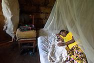 A mother with her three-week old newborn in Batamuliza Hururiro village, near Rukumo Health Center, Rwanda....