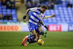 Sergi Canos of Brentford tackles Daniel Williams of Reading - Mandatory by-line: Jason Brown/JMP - 14/02/2017 - FOOTBALL - Madejski Stadium - Reading, England - Reading v Brentford - Sky Bet Championship