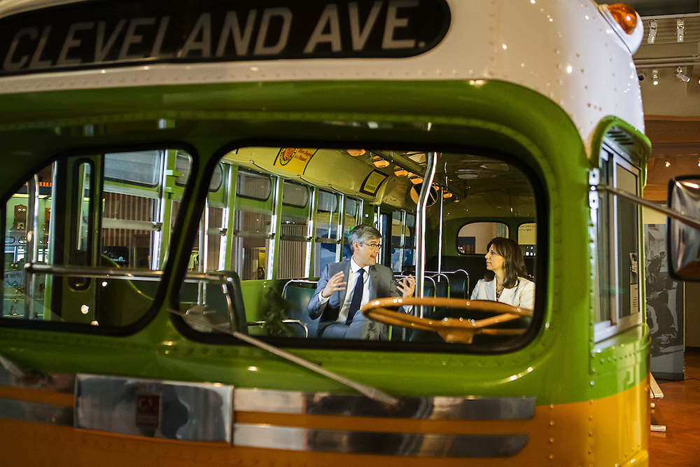 Mo Rocca talks to Patricia Mooradian on the Rosa Parks bus at the Henry Ford Museum of American Innovation. Photography by KMS Photography