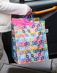 "© Licensed to London News Pictures. 01/06/2016. London, UK. A gift bag with the words ""HAPPY BIRTHDAY"" written on it, being carried by ALISON HUMPHREYS, the mother-in-law of Ronnie Wood, as she leave the Rolling Stones guitarist's London Home. Ronnie Wood and his wife Sally Humphreys gave birth to twins on May 30th and Ronnie Wood also turned 69 today (weds).  Photo credit: Ben Cawthra/LNP"