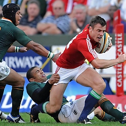 Tommy Bowe of the British and Irish Lions is tackled by Bryan Habana and Adi Jacobs of South Africa during the British and Irish Lions tour 2009