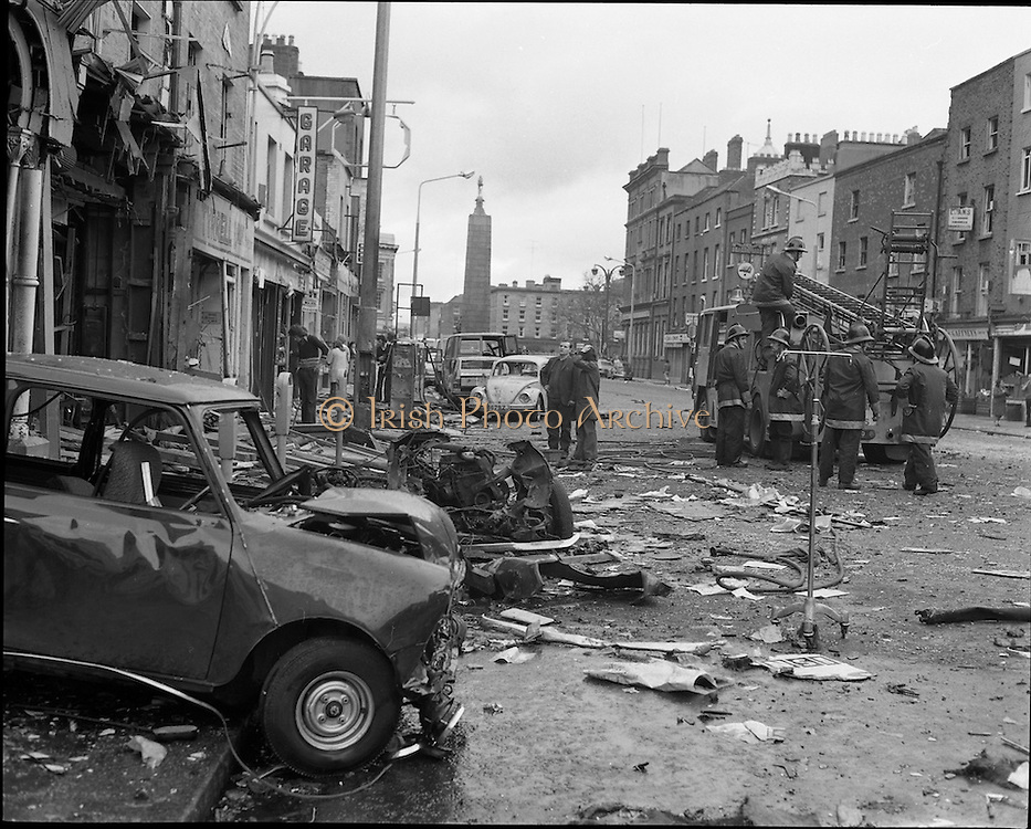 In what became known as the Dublin-Monaghan bombings, the first of three Dublin car bombs went off at approximately 17:28 in Parnell Street; the second went off at approximately 17:30 in Talbot Street and the third a few minutes later in South Leinster Street near the railings of Trinity College. The Monaghan bomb exploded some 90 minutes later. This is the scene in Parnell Street.<br /> 17/05/1974