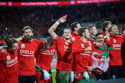 CARDIFF, WALES - Tuesday, October 13, 2015: Wales' Joe Ledley, Chris Gunter, Gareth Bale, Aaron Ramsey and Neil Taylor celebrate qualifying for the finals after the 2-0 victory over Andorra during the UEFA Euro 2016 qualifying Group B match at the Cardiff City Stadium. (Pic by Barry Coombs/Propaganda)