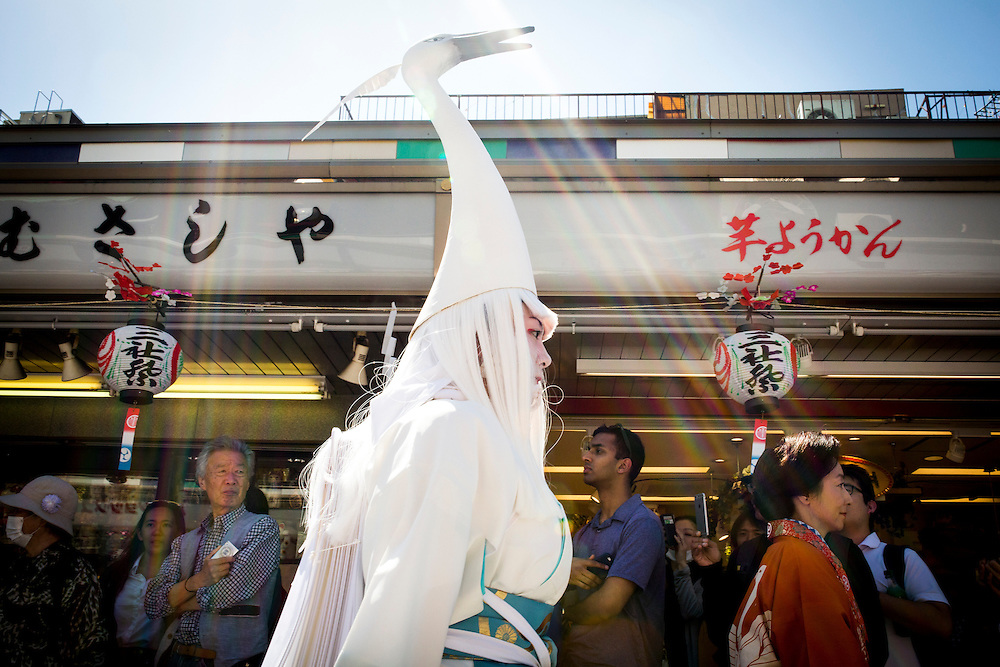 TOKYO, JAPAN - MAY 13: A traditionally dressed participant at Sanja Matsuri walk through the streets of Asakusa, Tokyo, Friday afternoon,  May 13, 2016. The Sanja Matsuri, the biggest of Tokyo's traditional 'Three Grand Festivals'. Held at Asakusa Shrine, a three-day weekend of boisterous traditional mikoshi (portable shrine) processions through the streets of Asakusa, with plenty of drinking, dancing, music and other lively types of fun. Organised by the Senso-ji temple in Tokyo, Over two million people festival goers draws into the streets. The gold and black lacquer mikoshi are the vehicles of the shrine's kami (deities) and the purpose of the processions is to bring luck, blessings and prosperity to the area and its inhabitants. Many of the mikoshi are so large, heavy and elaborate that dozens of people are required to carry them in the streets of Asakusa.<br /> <br /> Photo: Richard Atrero de Guzman