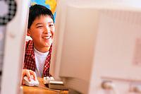 Boy Using Computer --- Image by © Jim Cummins/CORBIS