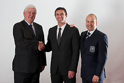 CARDIFF, WALES - Tuesday, December 14, 2010: Wales' new manager Gary Speed pictured with Football Association of Wales President Phil Pritchard (L) and Chief-Executive Jonathan Ford (R) at the Vale of Glamorgan Hotel after his appointment by the FAW. (Pic by: David Rawcliffe/Propaganda)