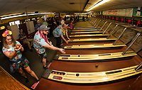 """""""Team Amoskeag"""" Makenzie White, Chuck Taggett, John Valliere and Adam Smith step up to take on the Skee Ball game during the NH Humane Society Indoor Triathlon at Funspot on Saturday.  (Karen Bobotas/for the Laconia Daily Sun)"""
