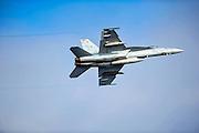 An F-18 Super Hornet banks left5. Photo by John Lill