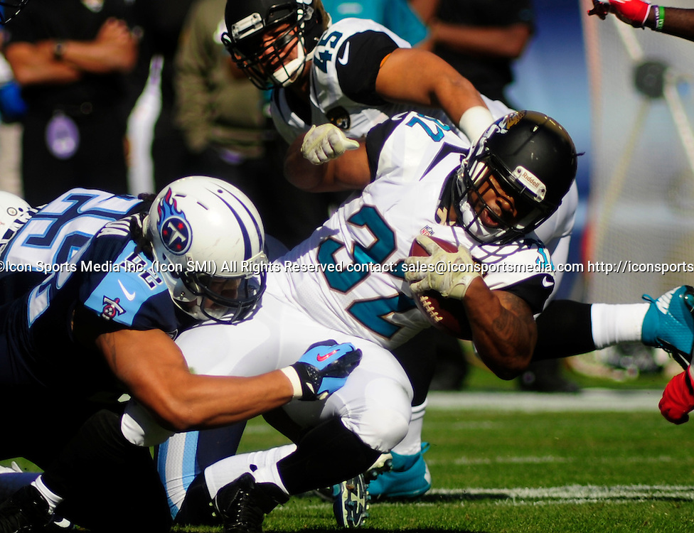 Nov. 10, 2013 - Nashville, TN, USA - Jacksonville Jaguars running back Maurice Jones-Drew (32) is tackled by Tennessee Titans defensive end Ropati Pitoitua (92) during 1st half action at LP Field in Nashville, Tn