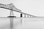"This image, ""Ebb Tide, Astoria"" was previsualized.  However, what I hadn't pre-visualized was the constant rain.  Working in the pre-dawn darkness, I had to hold an umbrella with one hand while setting up tripod and camera with the other.  Astoria Bridge (4.1 mi / 6.5km long) spans the mouth of the Columbia River between Astoria, Oregon and Point Ellice near Megler, Washington. Construction was started in 1962 and completed in 1966.  Nikon D200, 17-50mm/2.8, ND filters."
