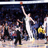 01 April 2018: Jump ball between Milwaukee Bucks center John Henson (31) and Denver Nuggets center Nikola Jokic (15) during the Denver Nuggets 128-125 victory over the Milwaukee Bucks, at the Pepsi Center, Denver, Colorado, USA.