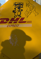 Shadow of passerby on DHL box.