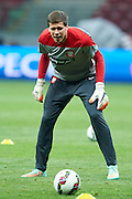 Poland's goalkeeper Wojciech Szczesny looks on the ball during official training one day before the EURO 2016 qualifying match between Poland and Germany on October 10, 2014 at the National stadium in Warsaw, Poland<br /> <br /> Picture also available in RAW (NEF) or TIFF format on special request.<br /> <br /> For editorial use only. Any commercial or promotional use requires permission.<br /> <br /> Mandatory credit:<br /> Photo by &copy; Adam Nurkiewicz / Mediasport