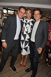 Left to right, JAKE ARNOTT and STEPHEN & ASSIA WEBSTER at a party to celebrate the publication on The House of Rumour by Jake Arnott held at The Ivy Club, West Street, London on 9th July 2012.