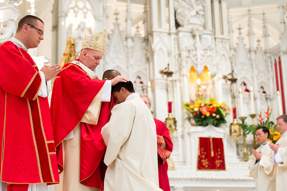 DENVER, CO - MAY 14: Denver Archbishop Samuel Aquila (L) lays hands on Deacon Fernando Londoño during his priest ordination at the Cathedral Basilica of the Immaculate Conception on May 14, 2016, in Denver, Colorado. (Photo by Daniel Petty/Denver Catholic)