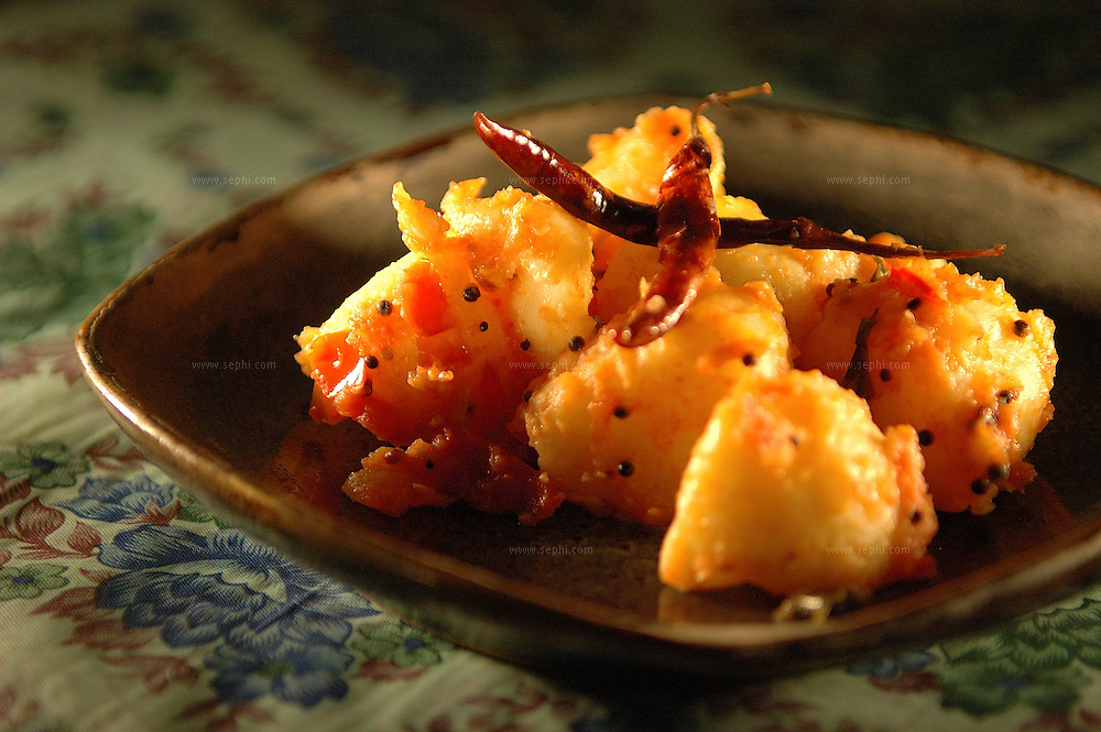 Sukha Aloo - Dry potatoes ( Recipe available upon request )