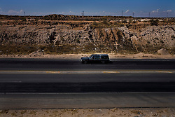 A funeral hearse drives to a cemetary in Ciudad Juarez, Mexico.  Mexico is undergoing a violent war with the nation's drug cartels and Ciudad Juarez has become the murder capital of Mexico, with over 4,000 murders in the past two years.  President Felipe Calderon has dispatched thousands of soldiers and federal police officers in order to contain the situation, but they have not been successful.