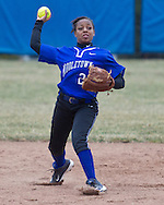 Middletown, New York - The Middletown shortstop throws the ball to first base in a varsity girls' softball game on April 7, 2014.