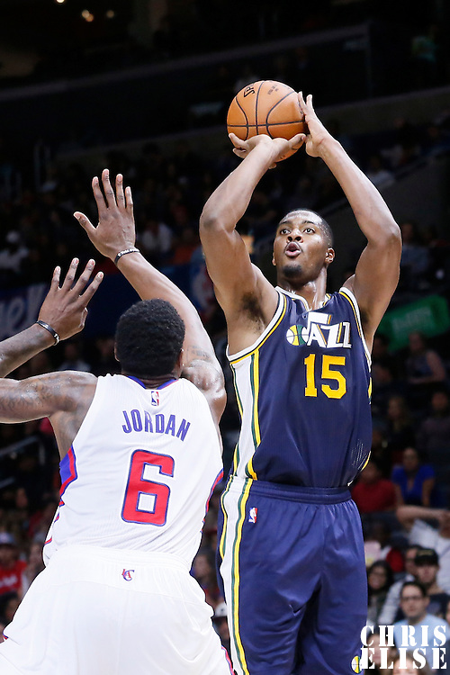 17 October 2014: Utah Jazz center Derrick Favors (15) takes a jump shot over Los Angeles Clippers center DeAndre Jordan (6) during the Los Angeles Clippers 101-97 victory over the Utah Jazz, in a preseason game, at the Staples Center, Los Angeles, California, USA.