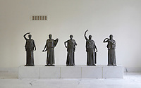 Bronze figures from Pompeii stand at the The National Archeological Museum in Naples, Italy.