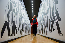 "© Licensed to London News Pictures. 07/02/2017. London, UK. A staff member views ""At The Parade"" by Vladmir Krinksy at the preview of an exhibition entitled ""Revolution Russian Art 1917-1932"", which marks the centenary of the Russian Revolution.  The exhibition runs from 11 February to 17 April 2017 at the Royal Academy of Arts in Piccadilly. Photo credit : Stephen Chung/LNP"