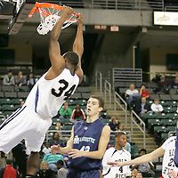 Forward Dantiel Daniels (34) with a slam for 2 against Mustand forward Alex Winter (42)