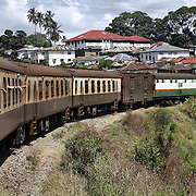 "The train from Nairobi to Mombasa passes through the outskirts of Mombasa. Also known as the ""Lunatic Express"", It was the railway line that built Kenya, linking the port town of Mombasa through the capital, Nairobi, to the shores of Lake Victoria and on to the Ugandan capital, Kampala. It cost $5m (in 1894 money) and countless workers died during its construction. There were derailments, collisions, tribal raids and attacks by lions. Yet despite becoming one of Kenya's national treasures and a vital economic artery for east Africa, the railway now lies in a state of disrepair. A South African consortium has taken it over and plans to invest millions, returning it to its former glory. But there has been a row over the railway's financing which may yet derail the .project. .."