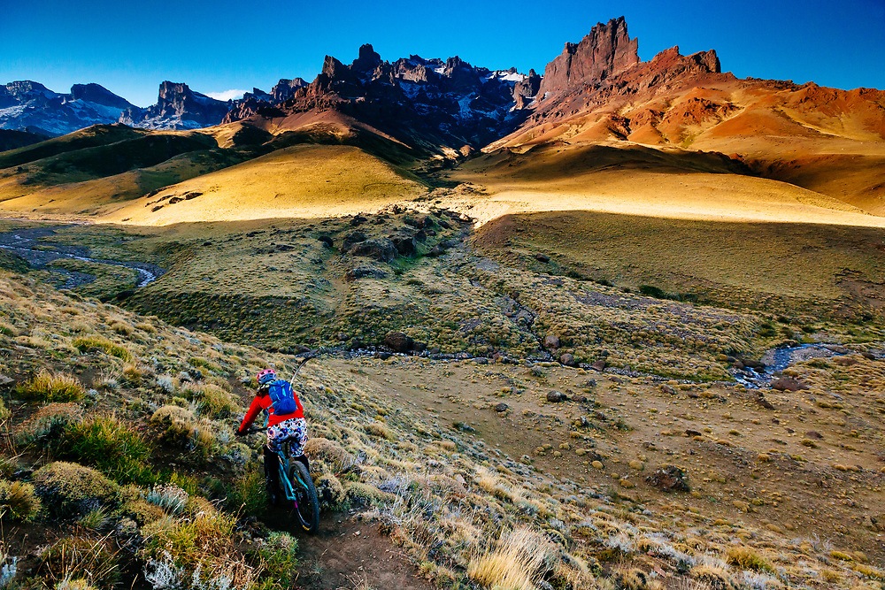 Private singletrack on Estancia Criollita with the Baguales Range and Trident in the background.