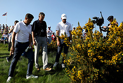 France's Mike Lorenzo-Vera and Romain Wattel talking the match referee about their ball landing in the bushes on the 3rd hole during day two of the Golf Sixes tournament at the Centurion Club, St Albans.