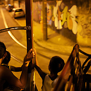 The Bondinho, tram or trolley car heads along the streets of Santa Teresa in the hills of Rio de Janeiro. The trap ride from the City Centre across the Lapa Aquaduct is popular for both tourists and locals. Rio de Janeiro,  Brazil. 21st September 2010. Photo Tim Clayton.