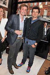 Left to right, NICK ENGLISH and ORLANDO BLOOM at the launch of the Bremont Boutique, 29 South Audley Street, London on 17th July 2012.
