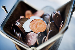 Purse filled with coins (Credit Image: © Image Source/ZUMAPRESS.com)