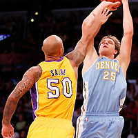 06 October 2013: Denver Nuggets center Timofey Mozgov (25) takes a jumpshot over Los Angeles Lakers center Robert Sacre (50) during the Denver Nuggets 97-88 victory over the Los Angeles Lakers at the Staples Center, Los Angeles, California, USA.