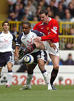 Photo: Leigh Quinnell.<br /> Tottenham Hotspur v Manchester United. The Barclays Premiership. 17/04/2006. Man Utds' John O'Shea battles with Tottenhams Jermaine Defoe.