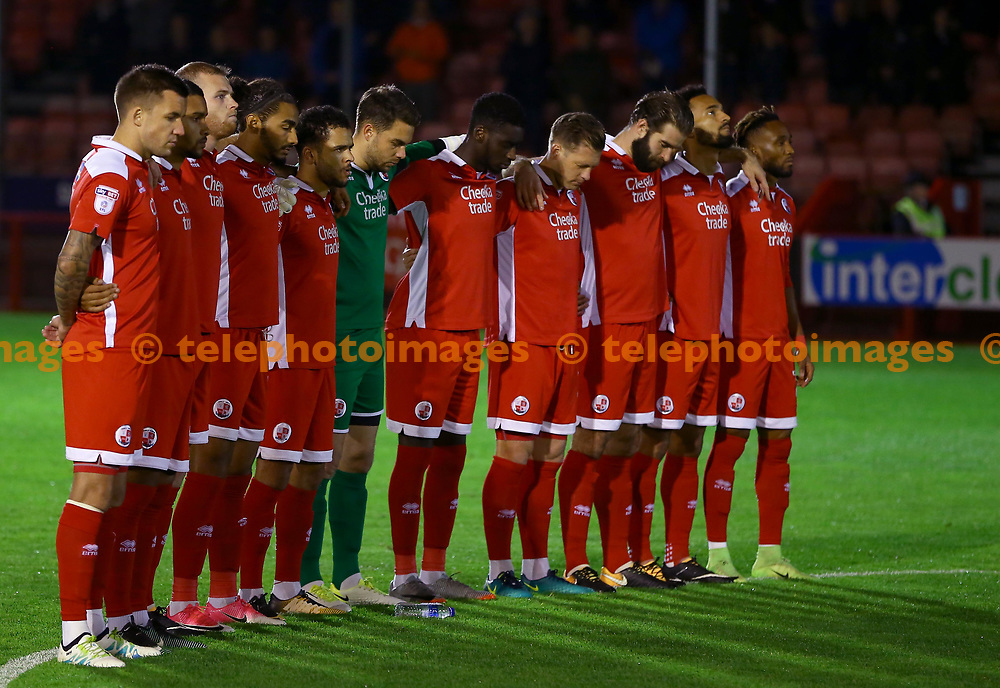 Players stand in silence in honour of Coach Turgut Esendaglis during the Sky Bet League 2 match between Crawley Town and Chesterfield at the Checkatrade Stadium in Crawley. 17 Oct 2017