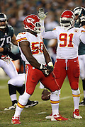 Kansas City Chiefs outside linebacker Tamba Hali (91) looks on as Kansas City Chiefs outside linebacker Justin Houston (50) celebrates a second quarter quarterback sack, one of two sacks that he made on one set of downs, during the NFL week 3 football game against the Philadelphia Eagles on Thursday, Sept. 19, 2013 in Philadelphia. The Chiefs won the game 26-16. ©Paul Anthony Spinelli