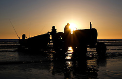 © Licensed to London News Pictures.12/06/15<br /> Saltburn by the Sea, England<br /> <br /> The crew of the fishing boat Senna prepare to launch as dawn breaks over Saltburn by the Sea.<br /> <br /> Photo credit : Ian Forsyth/LNP