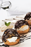 Profiteroles with grappa glass on back, Close up