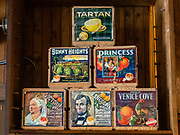 1900s wood fruit boxes: Tartan, Lincoln, Victoria, Venice Cove, Sunny Heights, and Princess brands. Dawson City was the center of the Klondike Gold Rush (1896–99), after which population rapidly declined, in Yukon, Canada. Dawson City shrank further during World War II after the Alaska Highway bypassed it 300 miles (480 km) to the south using Whitehorse as a hub. In 1953, Whitehorse replaced Dawson City as Yukon Territory's capital. Dawson City's population dropped to 600–900 through the 1960s-1970s, but later increased as high gold prices made modern placer mining operations profitable and tourism was promoted. In Yukon, the Klondike Highway is marked as Yukon Highway 2 to Dawson City.